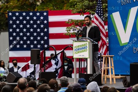 Actor Kal Penn appears on stage at an early vote rally at Weequahic Park, in Newark, N.J