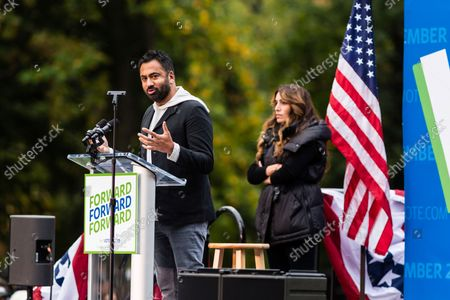 Stock Image of Actor Kal Penn speaks on stage at an early vote rally at Weequahic Park, in Newark, N.J
