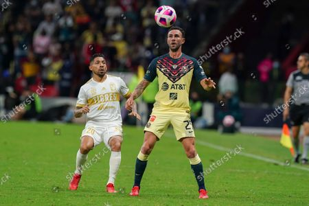 America's Miguel Layun, center, and Tigres' Javier Aquino go for the ball during a Mexican soccer league match at Azteca stadium in Mexico City