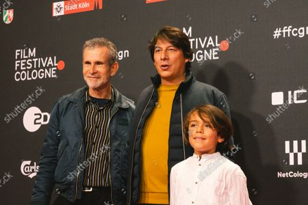 """Actor  Elia Gezer and Ulrich Matthes and film director Sebastian Ko attend the """"Geborgtes Weiss"""" photo call at Cologne film festival at Cologne filmpalast on Oct 23, 2021"""