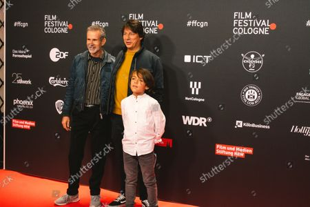 """Stock Photo of Actor  Elia Gezer and Ulrich Matthes and film director Sebastian Ko attend the """"Geborgtes Weiss"""" photo call at Cologne film festival at Cologne filmpalast on Oct 23, 2021"""
