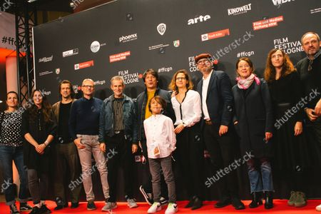 """Actor Florist Bajgora, Elia Gezer, Rainer Laupichler, Ulrich Matthes and film director Sebastian Ko attend the """"Geborgtes Weiss"""" photo call at Cologne film festival at Cologne filmpalast on Oct 23, 2021"""