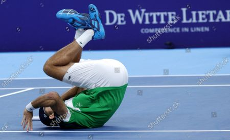 France's Fabrice Martin performs a somersault as he celebrates after winning the men's doubles final against Netherland's Wesley Koolhof and Jean-Julien Rojer at the European Open tennis tournament in Antwerp, Belgium