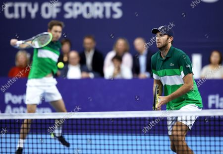 France's Nicolas Mahut, left, and Fabrice Martin in action during the men's doubles final against Netherland's Wesley Koolhof and Jean-Julien Rojer at the European Open tennis tournament in Antwerp, Belgium