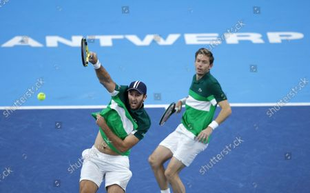France's Nicolas Mahut, right, and Fabrice Martin in action during the men's doubles final against Netherland's Wesley Koolhof and Jean-Julien Rojer at the European Open tennis tournament in Antwerp, Belgium