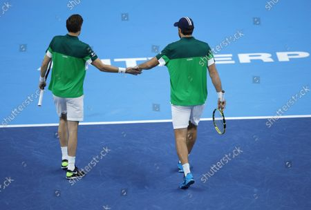 France's Nicolas Mahut, left, and Fabrice Martin congratulate each other after winning a point during the men's doubles final against Netherland's Wesley Koolhof and Jean-Julien Rojer at the European Open tennis tournament in Antwerp, Belgium