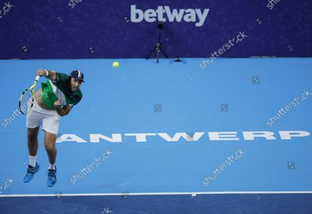 France's Fabrice Martin serves the ball during the men's doubles final against Netherland's Wesley Koolhof and Jean-Julien Rojer at the European Open tennis tournament in Antwerp, Belgium