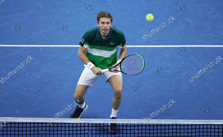 France's Nicolas Mahut prepares to make a return during the men's doubles final against Netherland's Wesley Koolhof and Jean-Julien Rojer at the European Open tennis tournament in Antwerp, Belgium