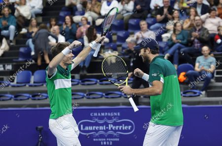 France's Nicolas Mahut, left, and Fabrice Martin react after winning the men's doubles final against Netherland's Wesley Koolhof and Jean-Julien Rojer at the European Open tennis tournament in Antwerp, Belgium
