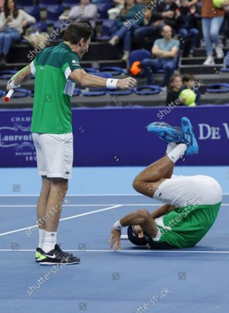 France's Nicolas Mahut, left, watches Fabrice Martin do a somersault as they react after winning the men's doubles final against Netherland's Wesley Koolhof and Jean-Julien Rojer at the European Open tennis tournament in Antwerp, Belgium