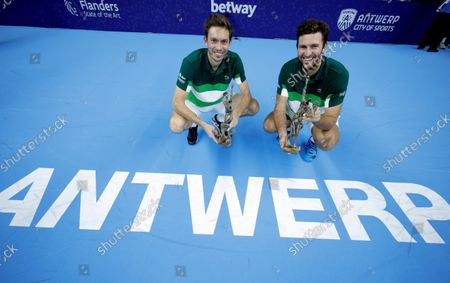 France's Nicolas Mahut and Fabrice Martin pose with their trophies after winning the men's doubles final against Netherland's Wesley Koolhof and Jean-Julien Rojer at the European Open tennis tournament in Antwerp, Belgium