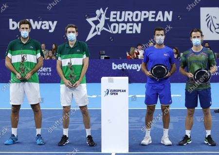 First place, France's Nicolas Mahut and Fabrice Martin, left, and Netherland's Wesley Koolhof and Jean-Julien Rojer, right, pose with their trophies after the men's doubles final at the European Open tennis tournament in Antwerp, Belgium