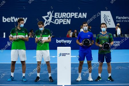 French Fabrice Martin, French Nicolas Mahut, Dutch Jean-Julien Rojer and Dutch Wesley Koolhof pictured after a doubles men game between Dutch pair Koolhof - Rojer and French Mahut - Martin, the finals of the European Open Tennis ATP tournament, in Antwerp, Sunday 24 October 2021.
