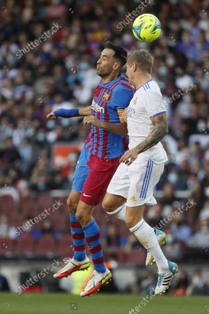 Sergio Busquets (5 FC Barcelona) and Toni Kroos (8 R.Madrid) disputing a ball with the head during, LaLiga Santander match between Barcelona and R.Madrid at Camp nou stadium in Barcelona, Spain.