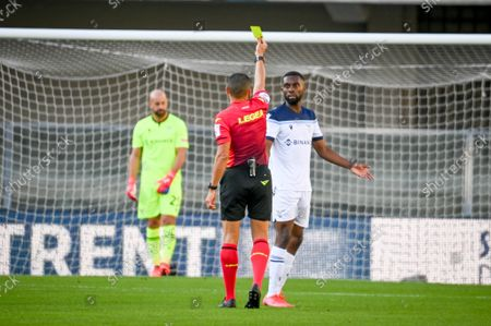 Stock Photo of The referee of the match Marco Piccinini shows yellow card to Jean-Daniel Akpa Akpro (Lazio)