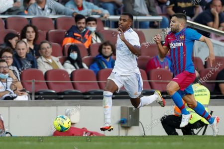 FC Barcelona's defender Jordi Alba (R) duels for the ball with Real Madrid's Brazilian winger Rodrygo Goes (L) during the Spanish LaLiga soccer match between FC Barcelona and Real Madrid at Camp Nou stadium in Barcelona, Catalonia, Spain, 24 October 2021.
