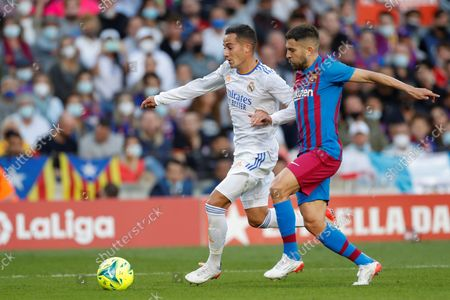 FC Barcelona's defender Jordi Alba (R) duels for the ball with Real Madrid's winger Lucas Vazquez (L) during the Spanish LaLiga soccer match between FC Barcelona and Real Madrid at Camp Nou stadium in Barcelona, Catalonia, Spain, 24 October 2021.
