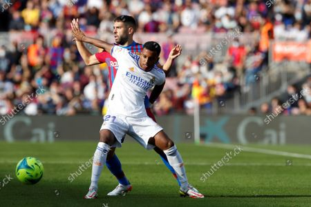 FC Barcelona's defender Jordi Alba (L) duels for the ball with Real Madrid's Brazilian winger Rodrygo Goes (R) during the Spanish LaLiga soccer match between FC Barcelona and Real Madrid at Camp Nou stadium in Barcelona, Catalonia, Spain, 24 October 2021.
