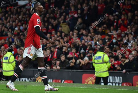 Manchester United's Paul Pogba leaves the pitch after being sent off during the English Premier League soccer match between Manchester United and Liverpool FC in Manchester, Britain, 24 October 2021.