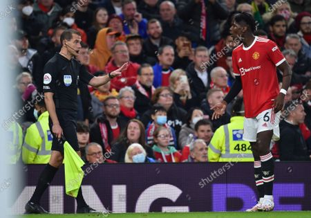 Manchester United's Paul Pogba (R) argues with assistant referee Lee Betts (L) during the English Premier League soccer match between Manchester United and Liverpool FC in Manchester, Britain, 24 October 2021.