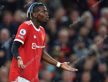 Manchester United's Paul Pogba reacts after being sent off during the English Premier League soccer match between Manchester United and Liverpool FC in Manchester, Britain, 24 October 2021.