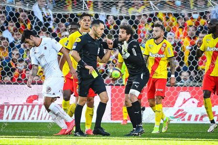 Jean-Louis LECA of Lens receives a yellow card from the referee Jeremie PIGNARD