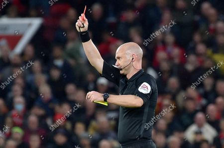 Referee Anthony Taylor shows a red card to Manchester United's Paul Pogba during the English Premier League soccer match between Manchester United and Liverpool at Old Trafford in Manchester, England