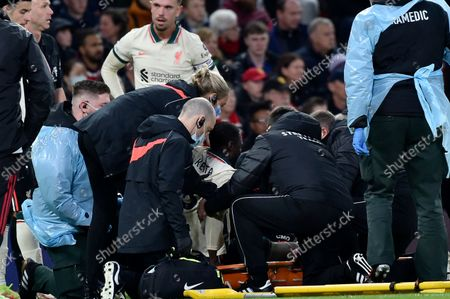 Stock Image of Liverpool's Naby Keita, center, is put on a stretcher after being fouled by Manchester United's Paul Pogba during the English Premier League soccer match between Manchester United and Liverpool at Old Trafford in Manchester, England