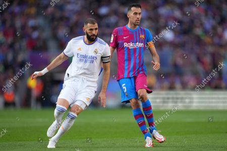 Stock Photo of Karim Benzema of Real Madrid and Sergio Busquets of FC Barcelona