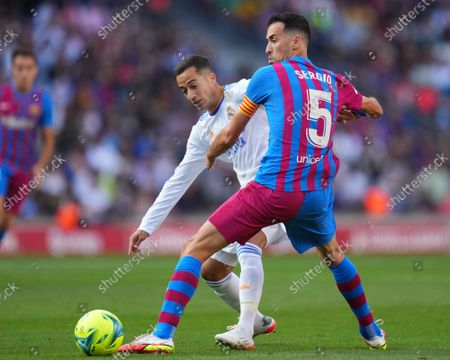 Stock Image of Sergio Busquets of FC Barcelona  and Lucas Vazquez of Real Madrid