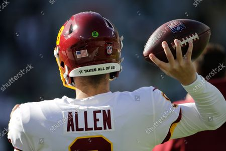 Washington Football Team's Kyle Allen warms up before an NFL football game against the Green Bay Packers, in Green Bay, Wis