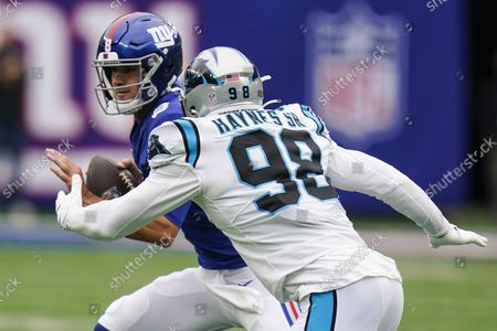Carolina Panthers defensive end Marquis Haynes (98) closes in on New York Giants quarterback Daniel Jones (8) during the first half of an NFL football game, in East Rutherford, N.J