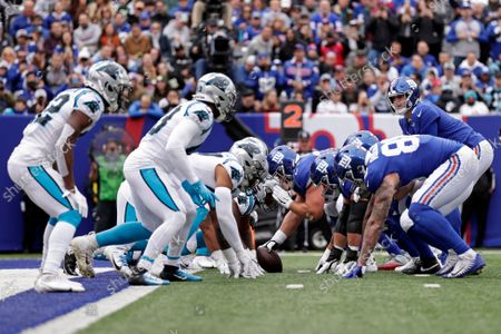 New York Giants quarterback Daniel Jones (8) lines up against the Carolina Panthers during an NFL football game, in East Rutherford, N.J