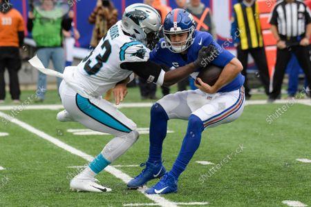Carolina Panthers defensive end Brian Burns (53) sacks New York Giants quarterback Daniel Jones (8) during the second half of an NFL football game, in East Rutherford, N.J