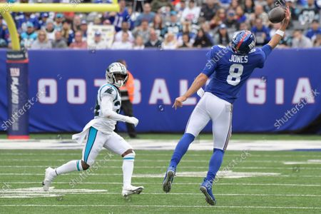 New York Giants quarterback Daniel Jones (8) catches a pass in front of Carolina Panthers' Sean Chandler (34) during the second half of an NFL football game, in East Rutherford, N.J