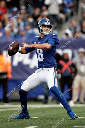 New York Giants quarterback Daniel Jones (8) passes against the Carolina Panthers during an NFL football game, in East Rutherford, N.J