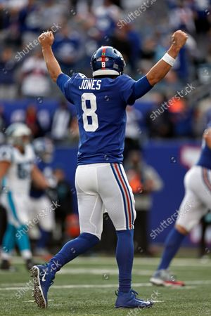 New York Giants quarterback Daniel Jones (8) reacts to a touchdown against the Carolina Panthers during an NFL football game, in East Rutherford, N.J