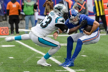 Stock Picture of Carolina Panthers defensive end Brian Burns (53) sacks New York Giants quarterback Daniel Jones (8) during the second half of an NFL football game, in East Rutherford, N.J