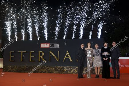 From left, Kit Harington, Angelina Jolie, Chloé Zhao, Gemma Chan, and Richard Madden pose on the red carpet for the movie 'Eternals' at the 16th edition of the Rome Film Fest in Rome