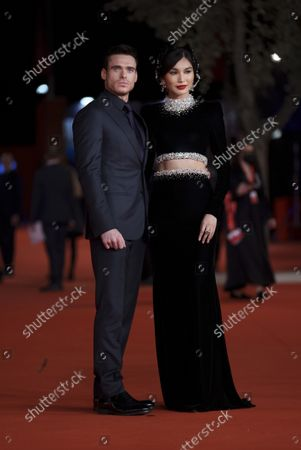 Actors Richard Madden, left, and Gemma Chan pose on the red carpet for the movie 'Eternals' at the 16th edition of the Rome Film Fest in Rome