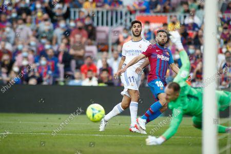 Marco Asensio of Real Madrid and Jordi Alba of FC Barcelona