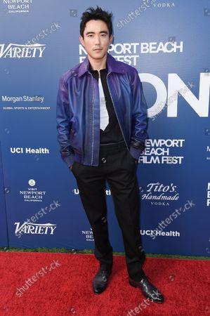 Justin H. Min arrives at the Newport Beach Film Festival 2021 Festival Honors, at Balboa Bay Resort in Newport Beach, Calif
