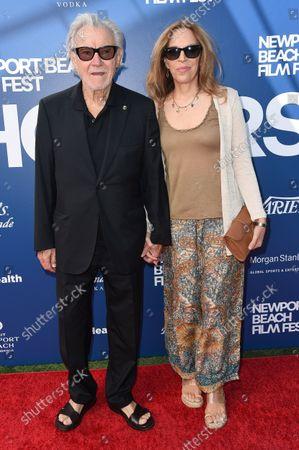 Stock Photo of Harvey Keitel, left, and and Daphna Kastner arrive at the Newport Beach Film Festival 2021 Festival Honors, at Balboa Bay Resort in Newport Beach, Calif