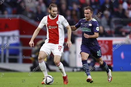 Stock Image of (lr) Daley Blind of Ajax, Mario Gotze or PSV Eindhoven during the Dutch Eredivisie match between Ajax Amsterdam and PSV Eindhoven at the Johan Cruijff arena on October 24, 2021 in Amsterdam, Netherlands.