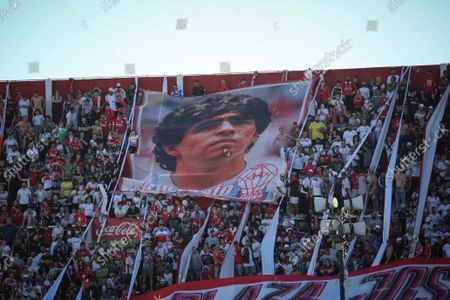 Huracan fans show a flag with Diego Maradona´s face during the match between Huracan vs San Lorenzo in Estadio Tomas A. Duco, Buenos Aires,  Argentina