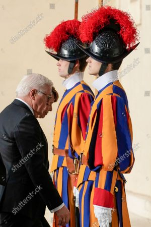 German President Frank-Walter Steinmeier, left, flanked by his wife Elke Budenbender, arrives for a private meeting with Pope Francis, at the Vatican