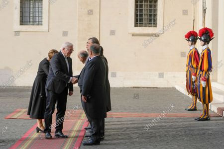 German President Frank-Walter Steinmeier, second from right, flanked by his wife Elke Budenbender, arrives for a private meeting with Pope Francis, at the Vatican
