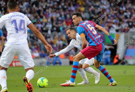 Lucas Vazquez and Sergio Busquets during the match between FC Barcelona and Real Madrid, corresponding to the week 10 of the Liga Santandere, played at the Camp Nou Stadium, on 24th October 2021, in Barcelona, Spain.  --