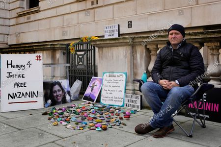 Richard Ratcliffe, husband of detained charity worker Nazanin Zaghari-Ratcliffe, sits opposite the Foreign Office in Westminster in London, . The husband of U.K. charity worker Zaghari-Ratcliffe, who has been detained for more than five years in Iran, has gone on a hunger strike again after a court decided she has to spend another year in prison