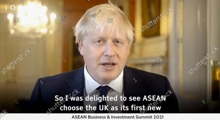 """In this image made from video released by ASEAN Business Advisory Council Brunei, British Prime Minister Boris Johnson delivers a speech via a televised address during the ASEAN Business and Investment summit, . Several leaders from ASEAN and their counterparts from dialogue countries deliver speeches through remote video at the ASEAN Business & Investment summit, a parallel meeting ahead of the ASEAN summit which will be hosted virtually by Brunei. Johnson said Monday he was """"delighted"""" to see the U.K. chosen as a new partner for dialogue with ASEAN"""